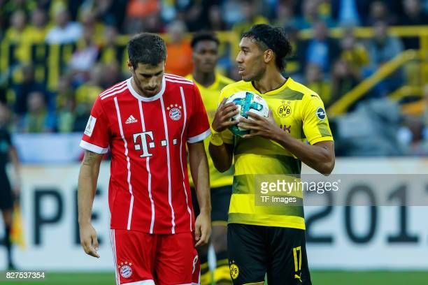 Robert Lewandowski of Bayern Muenchen and PierreEmerick Aubameyang of Dortmund looks on during the DFL Supercup 2017 match between Borussia Dortmund...