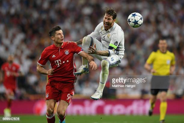Robert Lewandowski of Bayern Muenchen and Sergio Ramos of Real Madrid battle to win a header during the UEFA Champions League Quarter Final second...