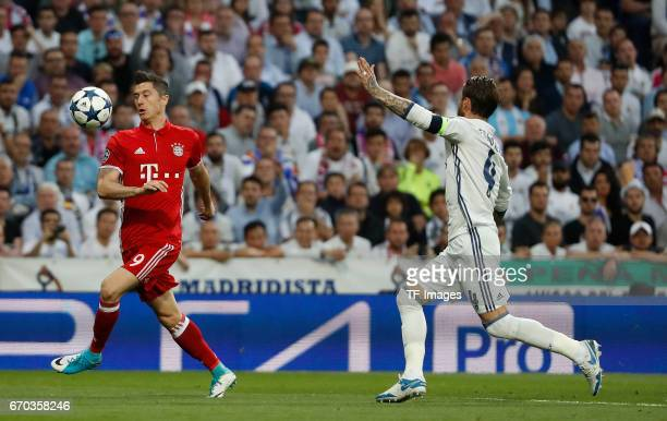 Robert Lewandowski of Bayern Muenchen and Sergio Ramos of Real Madrid battle for the ball during the UEFA Champions League Quarter Final second leg...