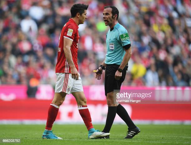 Robert Lewandowski of Bayern Muenchen argues with referee Marco Firtz during the Bundesliga match between Bayern Muenchen and Borussia Dortmund at...