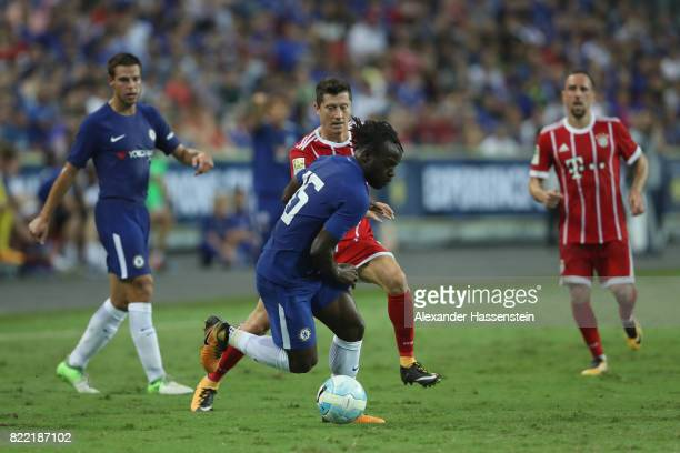 Robert Lewandowski of Bayern Muenchen battles for the ball with Victor Moses of Chelsea during the International Champions Cup 2017 match between...