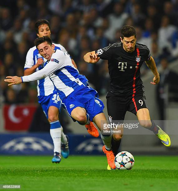 Robert Lewandowski of Bayern Muenchen battles with Hector Herrera of FC Porto during the UEFA Champions League Quarter Final first leg match between...