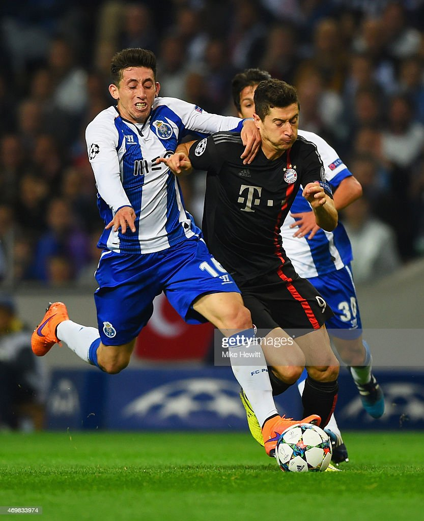 Robert Lewandowski of Bayern Muenchen battles with Hector Herrera of FC Porto during the UEFA Champions League Quarter Final first leg match between...