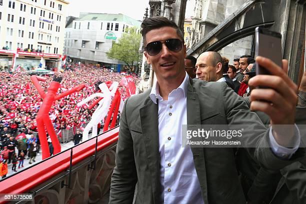 Robert Lewandowski of Bayern Muenchen celebrate winning the German Championship title on the town hall balcony at Marienplatz on May 15 2016 in...