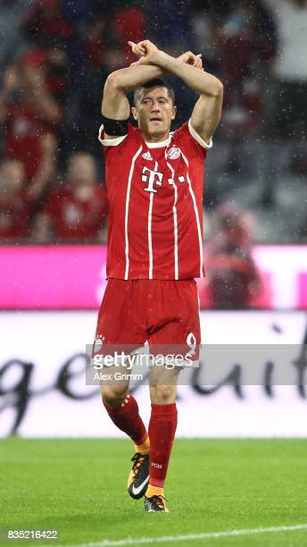 Robert Lewandowski of Bayern Muenchen celebrates after he scored a penalty during the Bundesliga match between FC Bayern Muenchen and Bayer 04...
