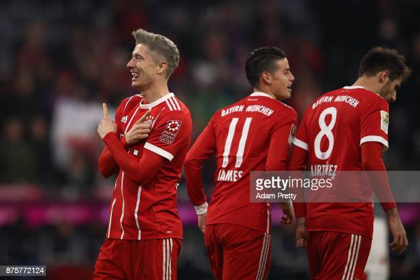 Robert Lewandowski of Bayern Muenchen celebrates after he scored his teams third goal to make it 30 during the Bundesliga match between FC Bayern...