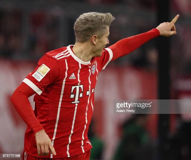 Robert Lewandowski of Bayern Muenchen celebrates after he scored his teams third goal to make it 30 during the Bundesliga match between FC Bayern...