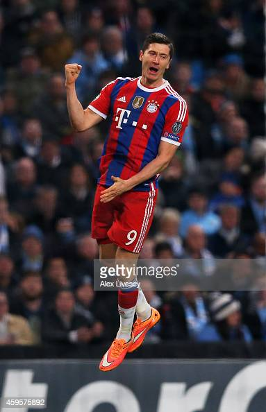 Robert Lewandowski of Bayern Muenchen celebrates after scoring his team's second goal during the UEFA Champions League Group E match between...