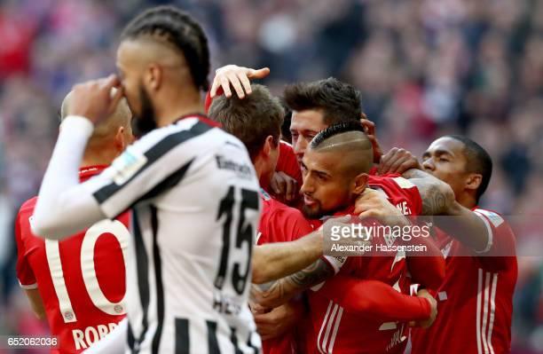 Robert Lewandowski of Bayern Muenchen celebrates after scoring his teams first goal during the Bundesliga match between Bayern Muenchen and Eintracht...