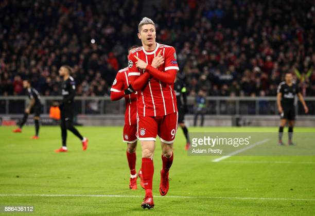 Robert Lewandowski of Bayern Muenchen celebrates after scoring his sides first goal during the UEFA Champions League group B match between Bayern...