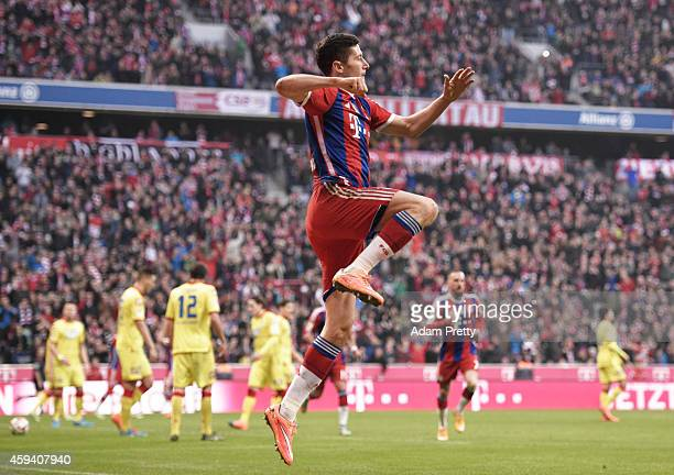 Robert Lewandowski of Bayern Muenchen celebrates after scoring the second goal during the Bundesliga match between FC Bayern Muenchen and 1899...