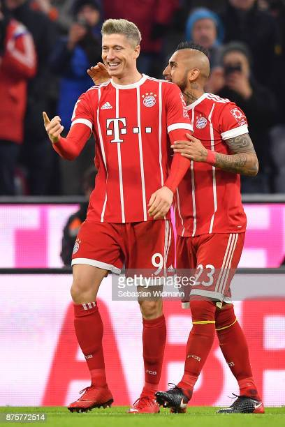 Robert Lewandowski of Bayern Muenchen celebrates after the scored his teams third goal to make it 30 with Arturo Vidal of Bayern Muenchen during the...