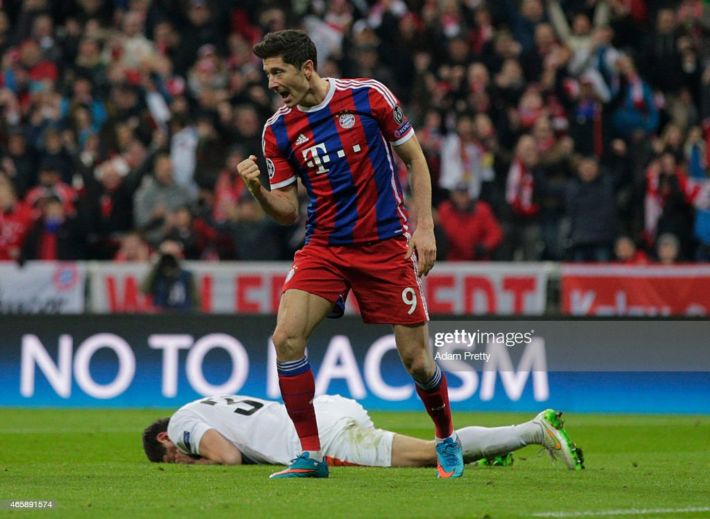 Robert Lewandowski of Bayern Muenchen celebrates as he scores their sixth goal during the UEFA Champions League Round of 16 second leg match between...