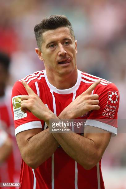 Robert Lewandowski of Bayern Muenchen celebrates having scored his teams first goal to make it 10 during the Bundesliga match between SV Werder...