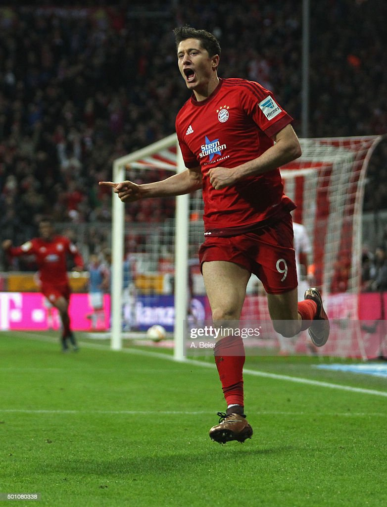 Robert Lewandowski of Bayern Muenchen celebrates his first goal during the Bundesliga match between FC Bayern Muenchen and FC Ingolstadt at Allianz Arena on December 12, 2015 in Munich, Germany.