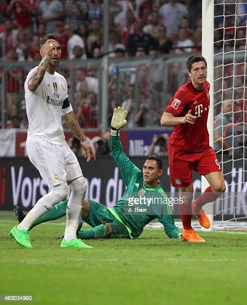 Robert Lewandowski of Bayern Muenchen celebrates his goal as goalkeeper Keylor Navas and Sergio Ramos of Real Madrid react during the Audi Cup final...