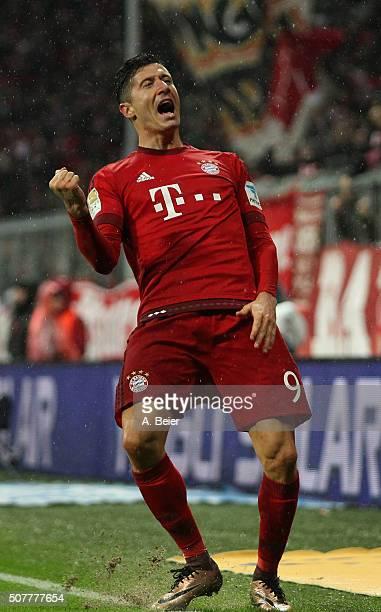 Robert Lewandowski of Bayern Muenchen celebrates his second goal during the Bundesliga match between FC Bayern Muenchen and 1899 Hoffenheim at...