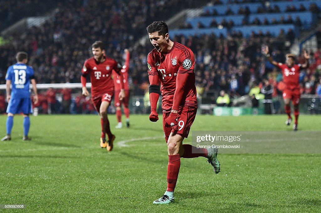 Robert Lewandowski of Bayern Muenchen celebrates scoring his side's first goal during the DFB Cup quarter final match between VfL Bochum and Bayern Muenchen at Rewirpower Stadium on February 10, 2016 in Bochum, Germany.