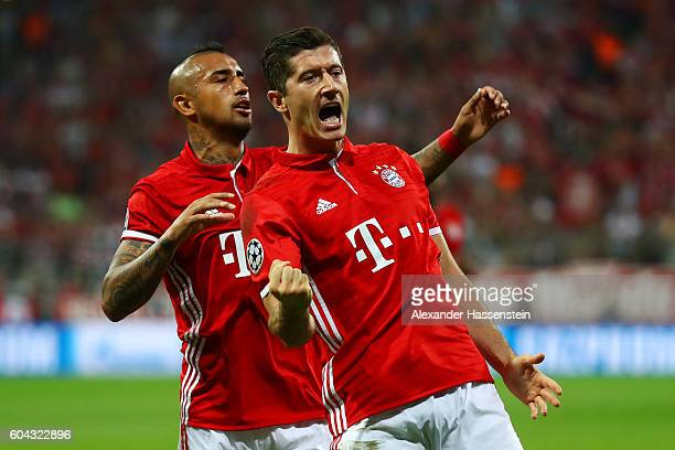 Robert Lewandowski of Bayern Muenchen celebrates scoring his sides first goal with Arturo Vidal of Bayern Muenchen during the UEFA Champions League...
