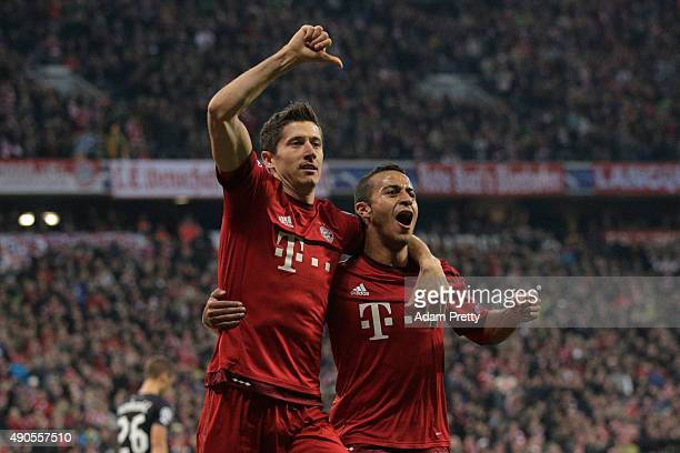 Robert Lewandowski of Bayern Muenchen celebrates scoring his teams second goal with Thiago Alcantara of Bayern Muenchen during the UEFA Champions...