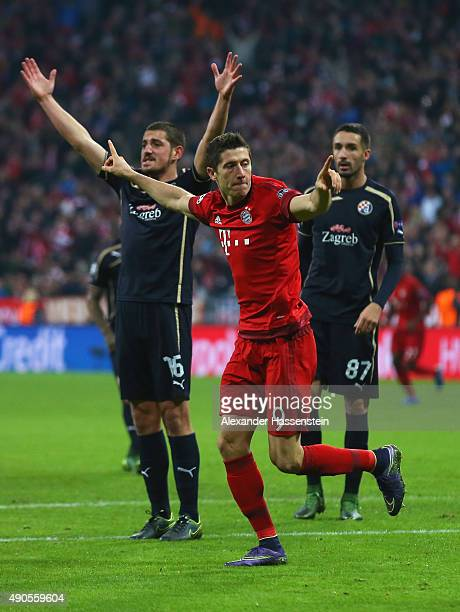 Robert Lewandowski of Bayern Muenchen celebrates scoring his teams fifth goal during the UEFA Champions League Group F match between FC Bayern...