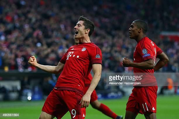 Robert Lewandowski of Bayern Muenchen celebrates scoring his teams fifth goal during the UEFA Champions League Group F match between FC Bayern...