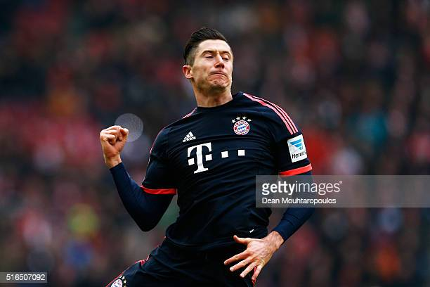 Robert Lewandowski of Bayern Muenchen celebrates scoring his teams first goal of the game during the Bundesliga match between 1 FC Koeln and FC...