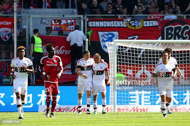 Robert Lewandowski of Bayern Muenchen celebrates scoring his team's first goal with his team mate Philipp Lahm during the Bundesliga match between FC...