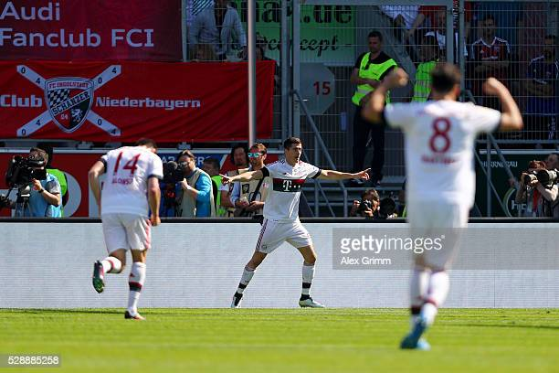 Robert Lewandowski of Bayern Muenchen celebrates scoring his team's second goal during the Bundesliga match between FC Ingolstadt and FC Bayern...