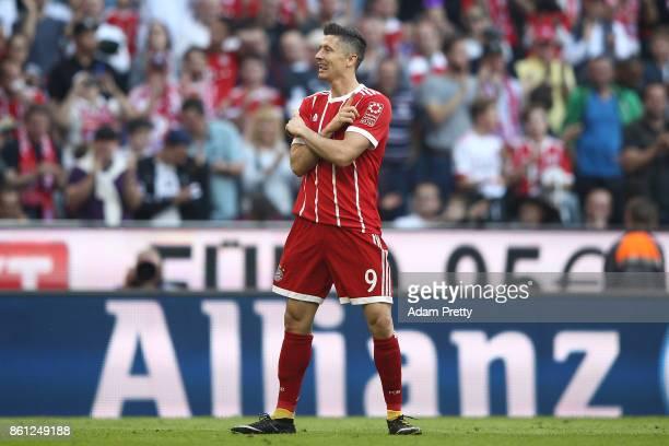 Robert Lewandowski of Bayern Muenchen celebrates scoring his teams fourth goal to make it 40 during the Bundesliga match between FC Bayern Muenchen...