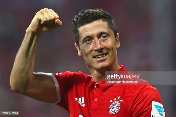 Robert Lewandowski of Bayern Muenchen celebrates scoring the 3rd team goal during the Bundesliga match between Bayern Muenchen and Werder Bremen at...