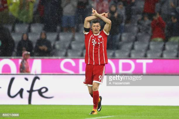 Robert Lewandowski of Bayern Muenchen celebrates scoring the 3rd team goal during the Bundesliga match between FC Bayern Muenchen and Bayer 04...