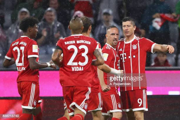 Robert Lewandowski of Bayern Muenchen celebrates scoring the 3rd team goal with his team mates during the Bundesliga match between FC Bayern Muenchen...