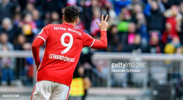 Robert Lewandowski of Bayern Muenchen celebrates the fourth goal for his team during the Bundesliga match between Bayern Muenchen and Hamburger SV at...