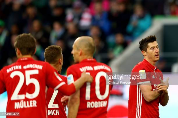 Robert Lewandowski of Bayern Muenchen celebrates the second goal during the Bundesliga match between VfL Wolfsburg and Bayern Muenchen at Volkswagen...