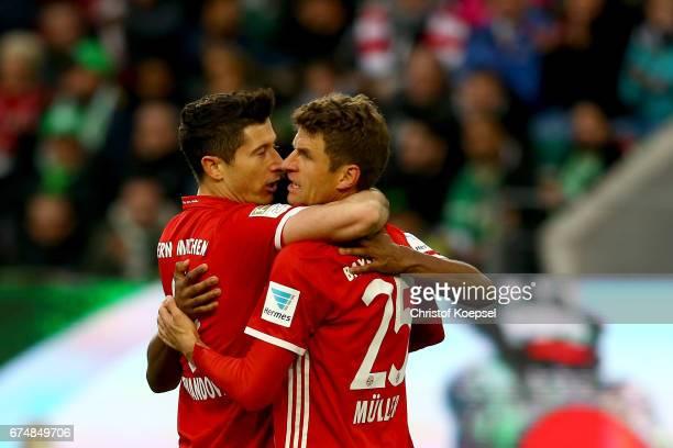 Robert Lewandowski of Bayern Muenchen celebrates the second goal with Thomas Mueller of Bayern Muenchen during the Bundesliga match between VfL...