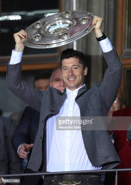 Robert Lewandowski of Bayern Muenchen celebrates winning the 67th German Championship title on the town hall balcony at Marienplatz on May 20 2017 in...