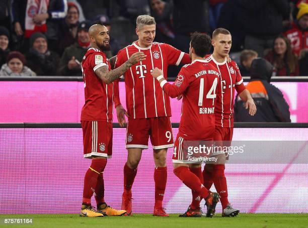 Robert Lewandowski of Bayern Muenchen celebrates with Arturo Vidal of Bayern Muenchen Juan Bernat of Bayern Muenchen and Joshua Kimmich of Bayern...
