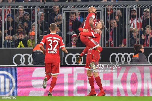 Robert Lewandowski of Bayern Muenchen celebrates with Arturo Vidal of Bayern Muenchen after he scored a goal to make it 20 during the Bundesliga...