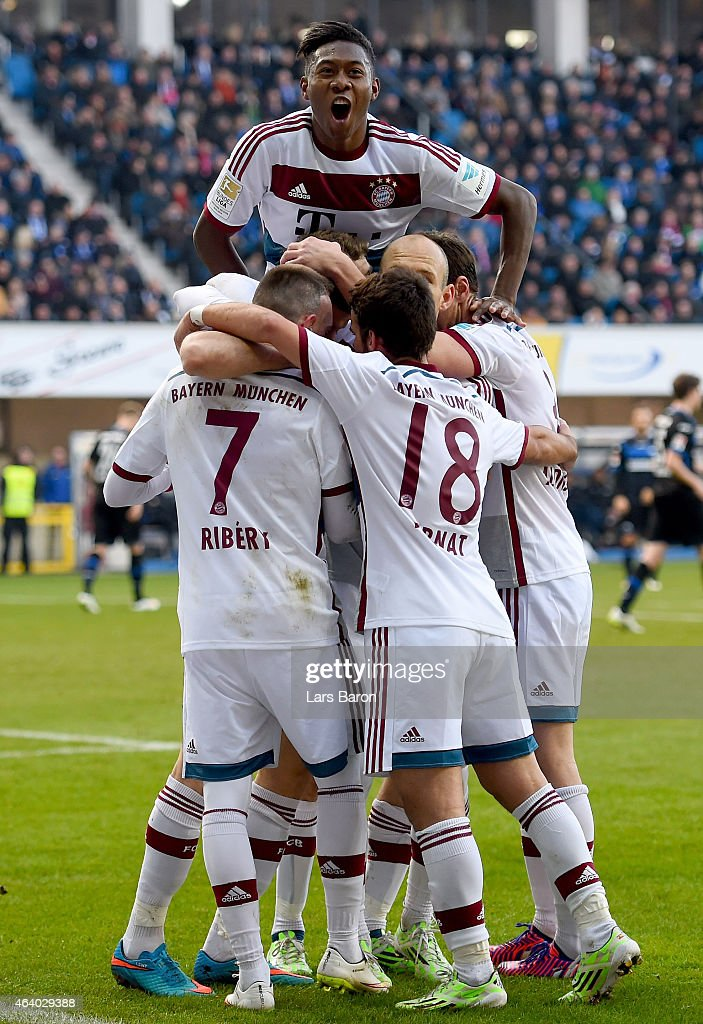 Robert Lewandowski of Bayern Muenchen celebrates with David Alaba and other team mates after scoring his teams first goal during the Bundesliga match...