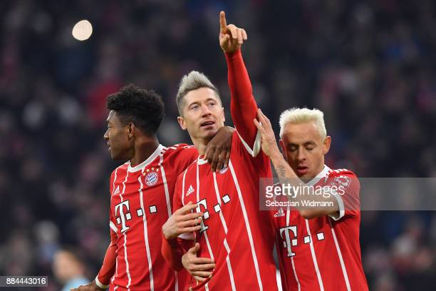 Robert Lewandowski of Bayern Muenchen celebrates with David Alaba of Bayern Muenchen and Rafinha of Bayern Muenchen after he scored a penalty goal to...