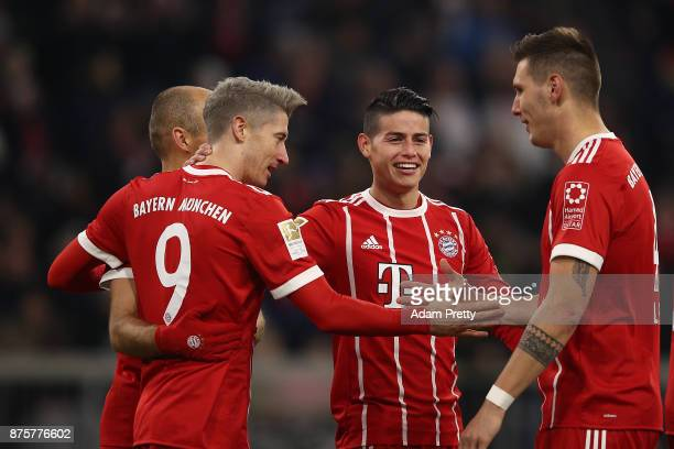 Robert Lewandowski of Bayern Muenchen celebrates with his team after he scored his teams third goal to make it 30 during the Bundesliga match between...