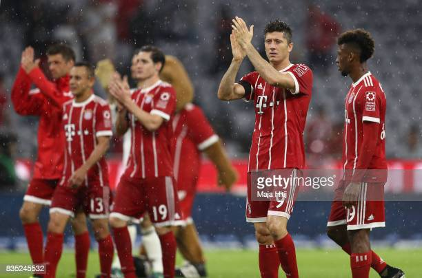 Robert Lewandowski of Bayern Muenchen celebrates with team and fans after the Bundesliga match between FC Bayern Muenchen and Bayer 04 Leverkusen at...
