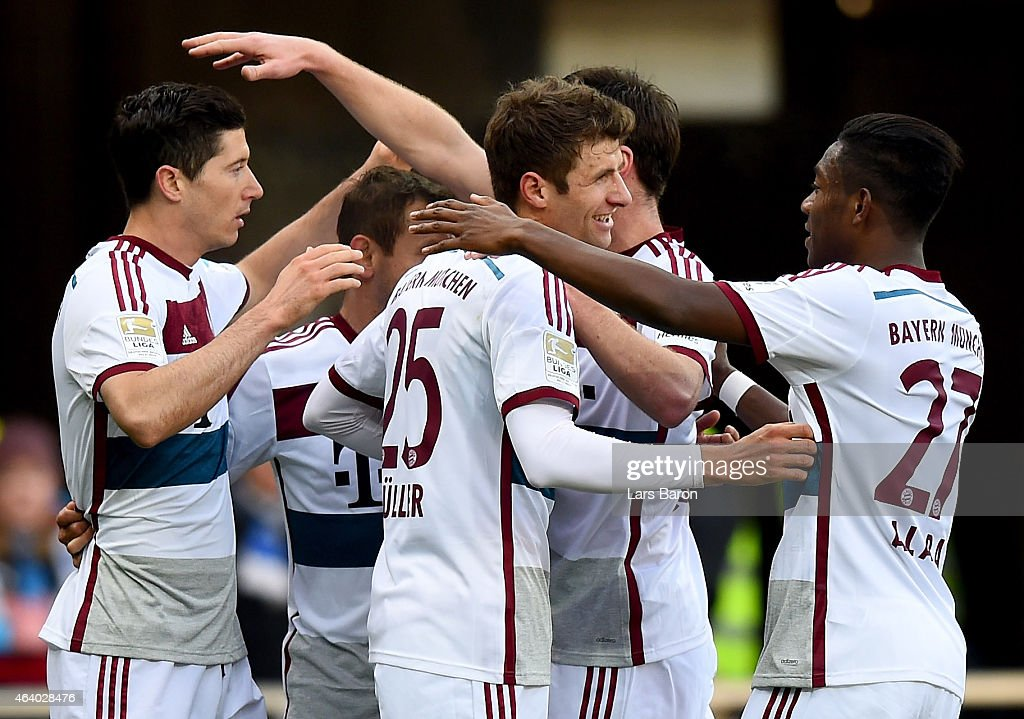 Robert Lewandowski of Bayern Muenchen celebrates with team mates after scoring his teams first goal during the Bundesliga match between SC Paderborn...