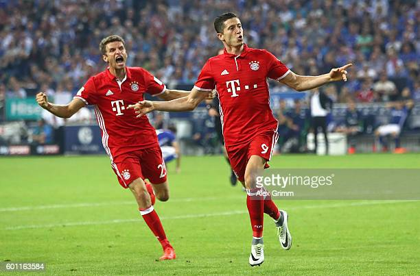 Robert Lewandowski of Bayern Muenchen celebrates with Thomas Mueller of Bayern Muenchen after scoring his sides first goal during the Bundesliga...