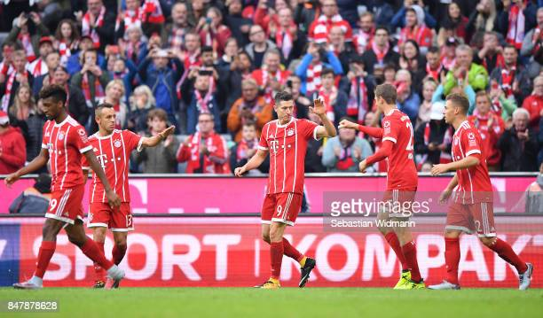 Robert Lewandowski of Bayern Muenchen celerbates with his team after he score his teams fourth goal to make it 40 during the Bundesliga match between...