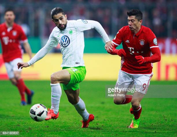 Robert Lewandowski of Bayern Muenchen challenges Ricardo Rodriguez of VfL Wolfsburg during the DFB Cup Round Of 16 match between Bayern Muenchen and...