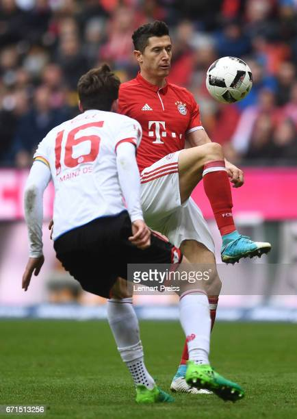 Robert Lewandowski of Bayern Muenchen challenges Stefan Bell of 1 FSV Mainz 05 during the Bundesliga match between Bayern Muenchen and 1 FSV Mainz 05...