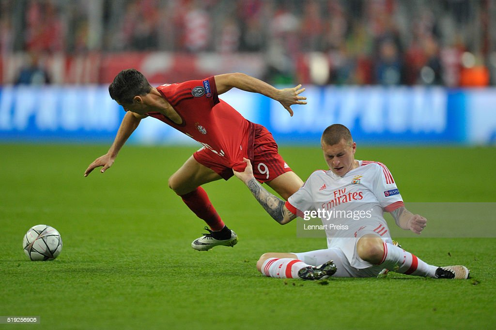 Robert Lewandowski of Bayern Muenchen challenges Victor Lindeloef of Benfica during the UEFA Champions League Quarter Final first leg match between...