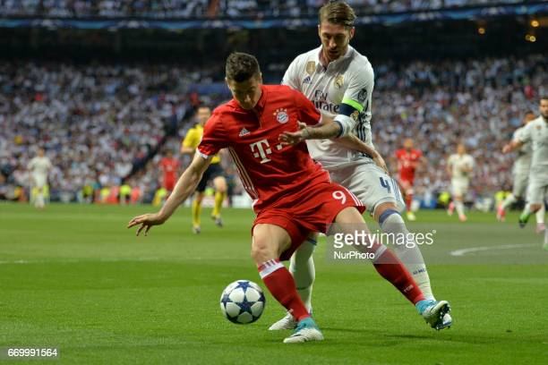 Robert Lewandowski of Bayern Muenchen competes for the ball with Sergio Ramos of Real Madrid CF during the UEFA Champions League Quarter Final second...